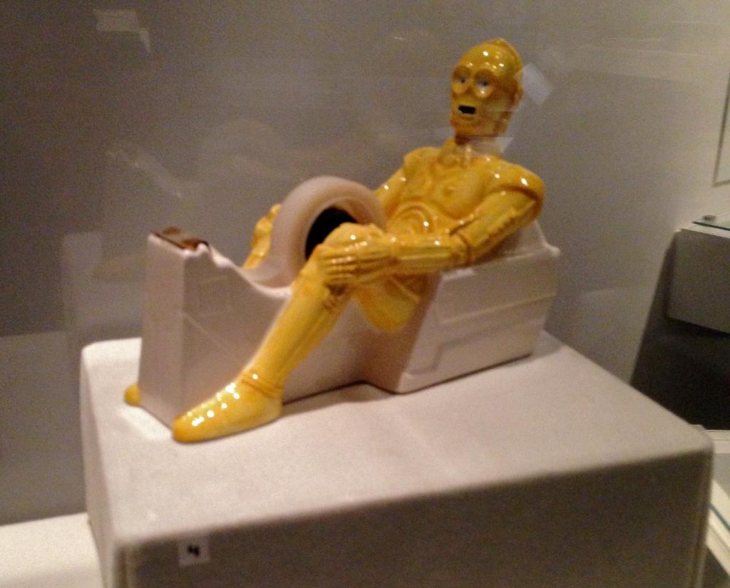 A disturbingly phallic C-3PO tape dispenser.