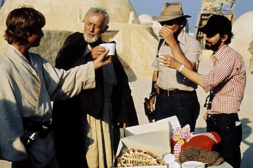 Alec Guinness celebrates his birthday on location in Tunisia.