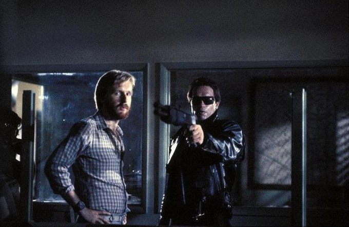 James Cameron (left) and Arnold Schwarzenegger on the set of The Terminator (1984).