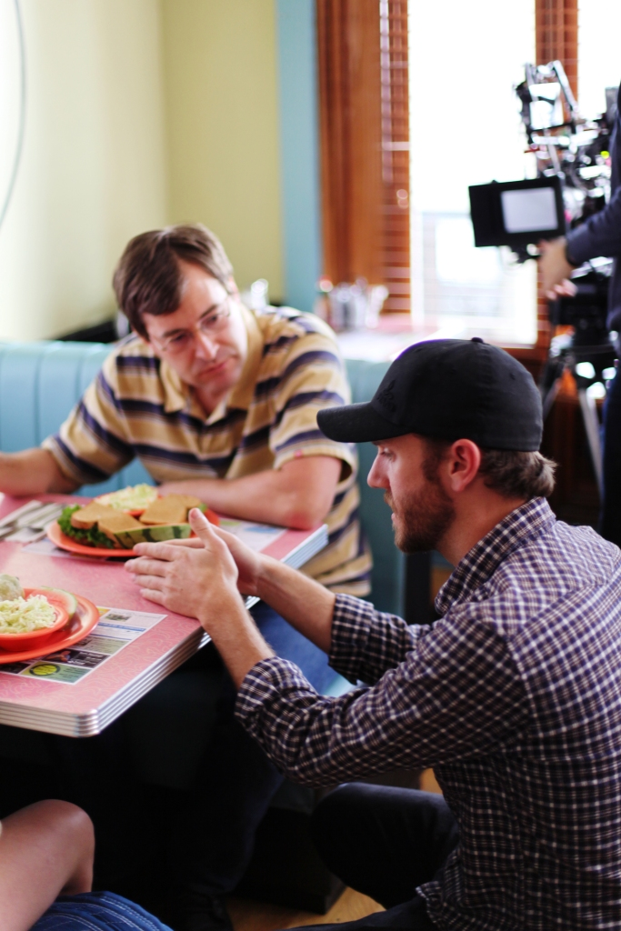 Actor Mark Duplass (left) and director Charlie McDowell (right) prepare to shoot one of the film's few scenes away from the main house location.