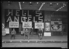 Three men wait outside the Kentucky Theater in Lexington, Kentucky as part of a publicity stunt to promote the Howard Hawks directed Hell's Angels (1930).