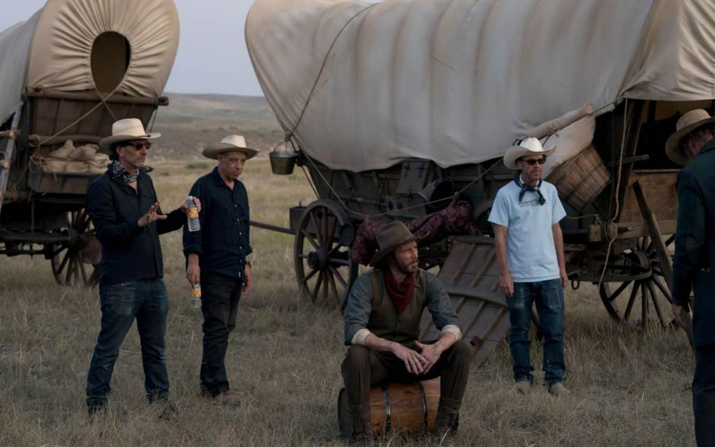 The Coen Brothers and cinematographer Bruno Delbonnel on the set of The Ballad of Buster Scruggs.